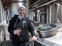 Adam Robbings on the brewdeck at Reuben's Brewtap.