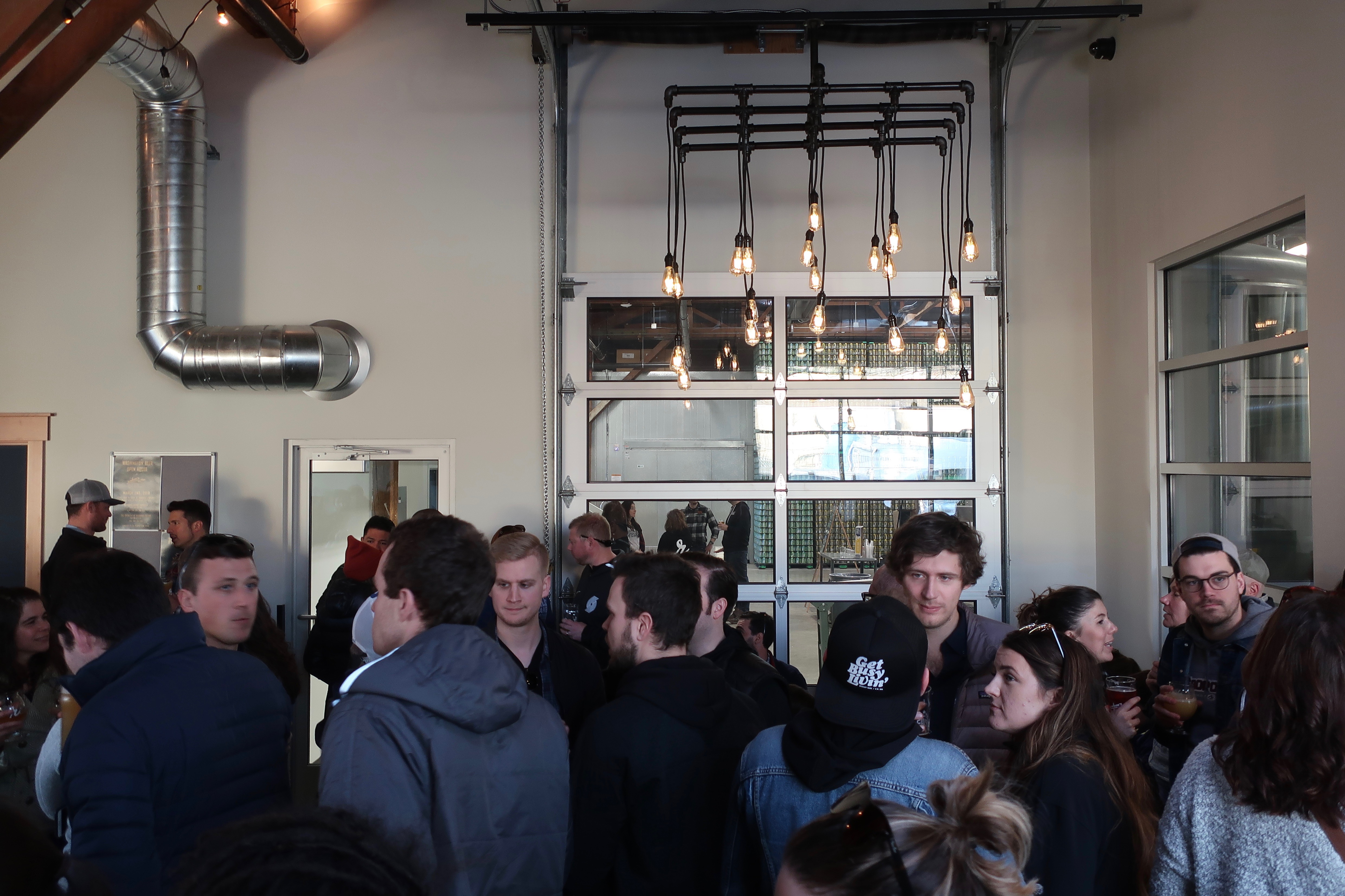 Patrons inside Reuben's Brewtap in Seattle during its Grand Opening.