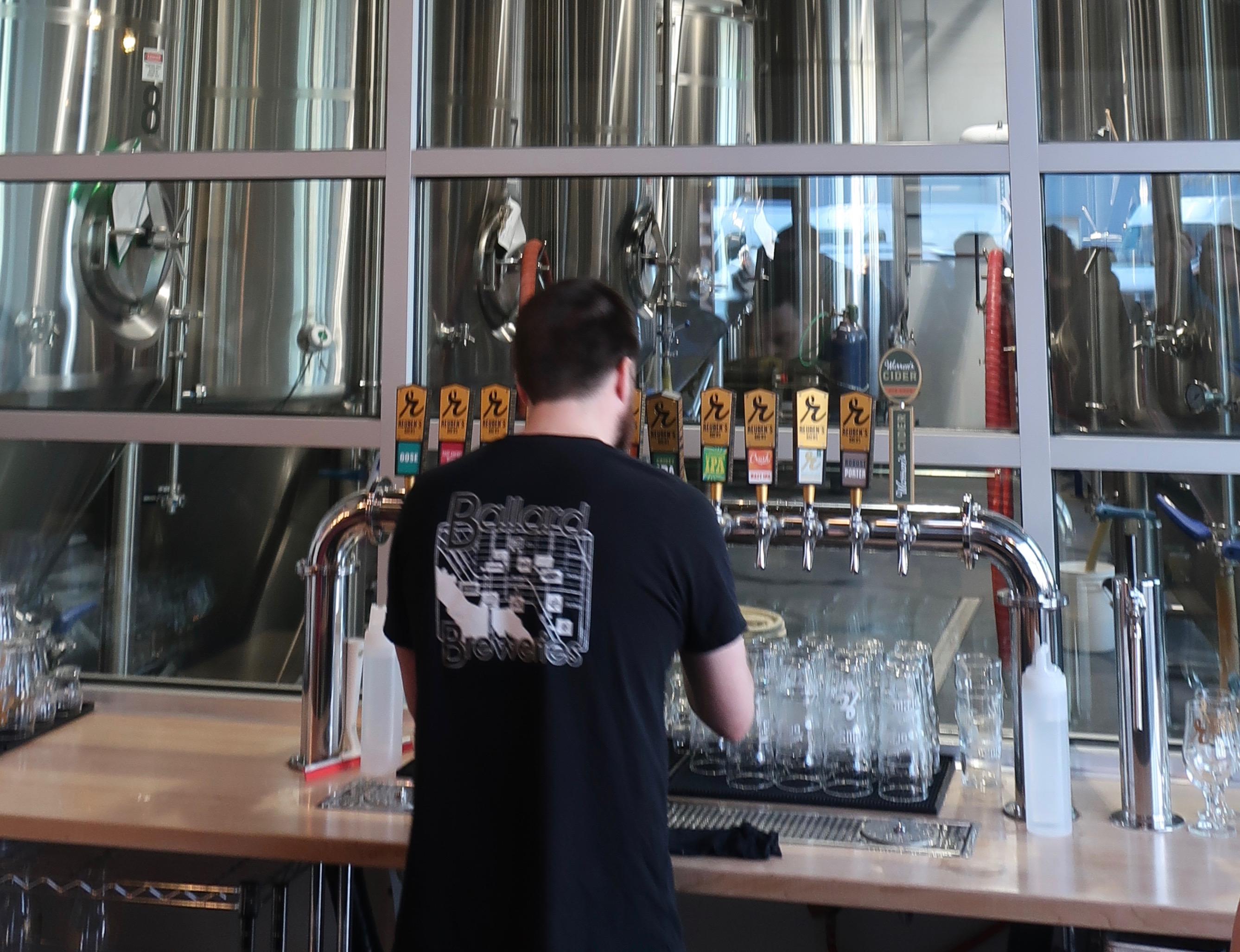 Pouring draft beer at Reuben's Brewtap.