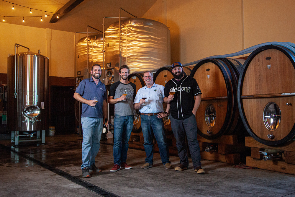 Matt Van Wyk, Doug Coombs, Marty Compton, and Brian Coombs at Alesong Brewing. (image courtesy of Ninkasi Brewing)