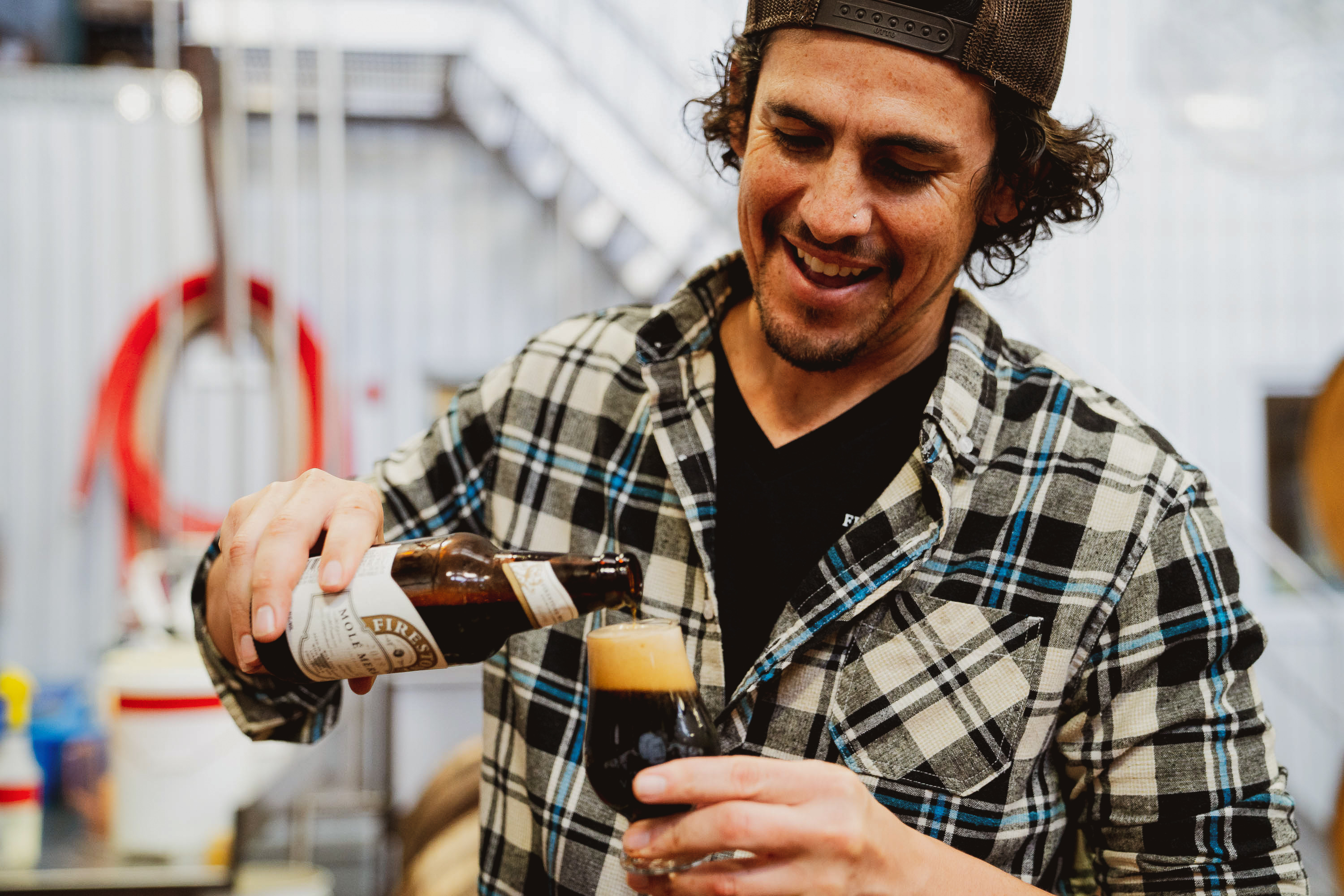 image of Eric Ponce pouring Mole Merkin courtesy of Firestone Walker Brewing