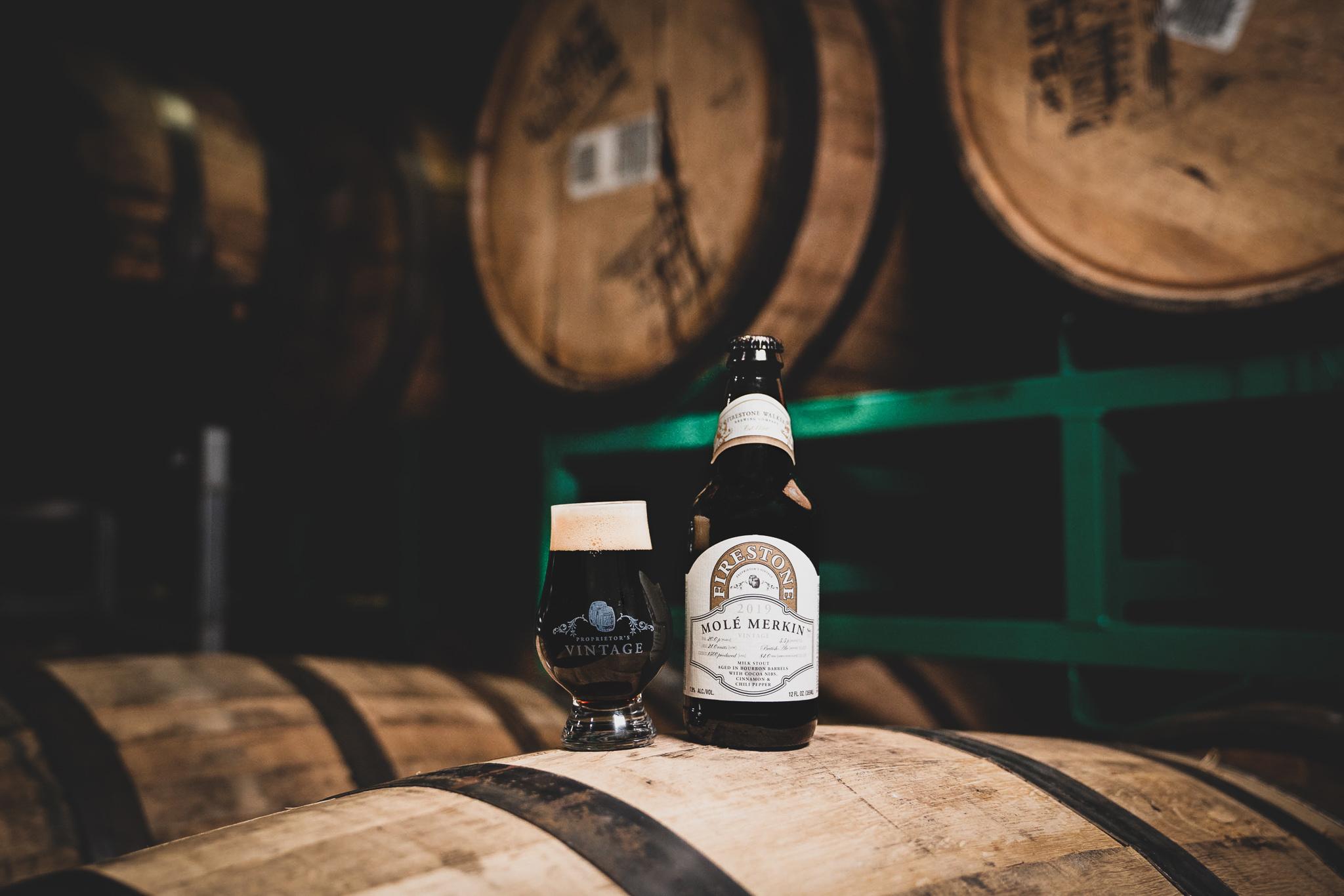 image of Mole Merkin sitting on barrels courtesy of Firestone Walker Brewing