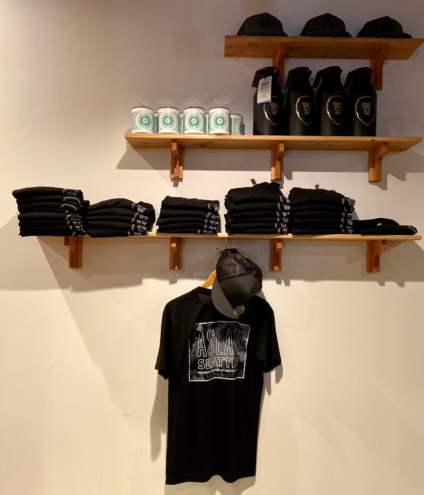 Aslan Brewing Seattle merchandise is available at its newest location.