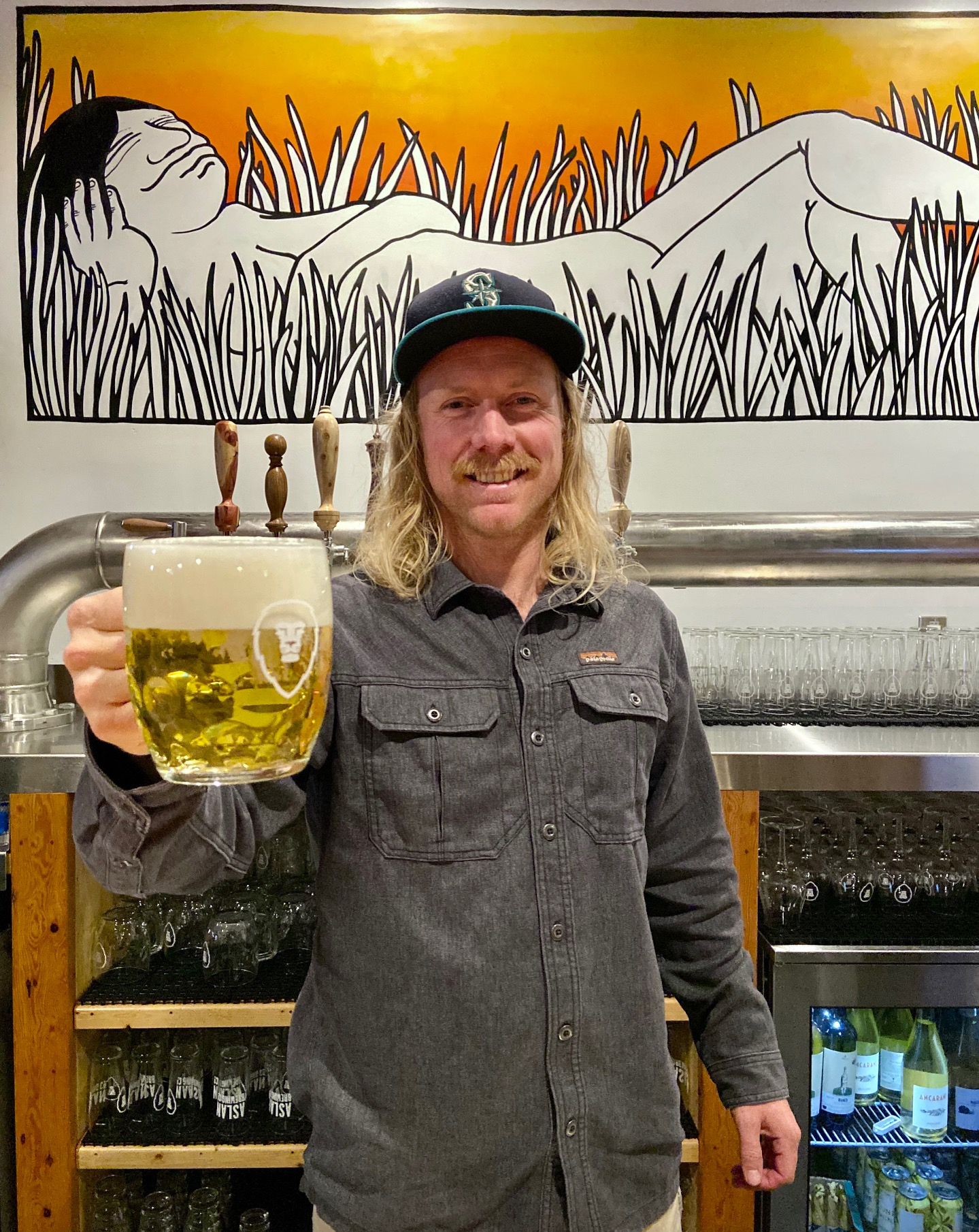 Co-Owner of Aslan Brewing, Boe Trosset at the new Aslan Brewing Seattle.
