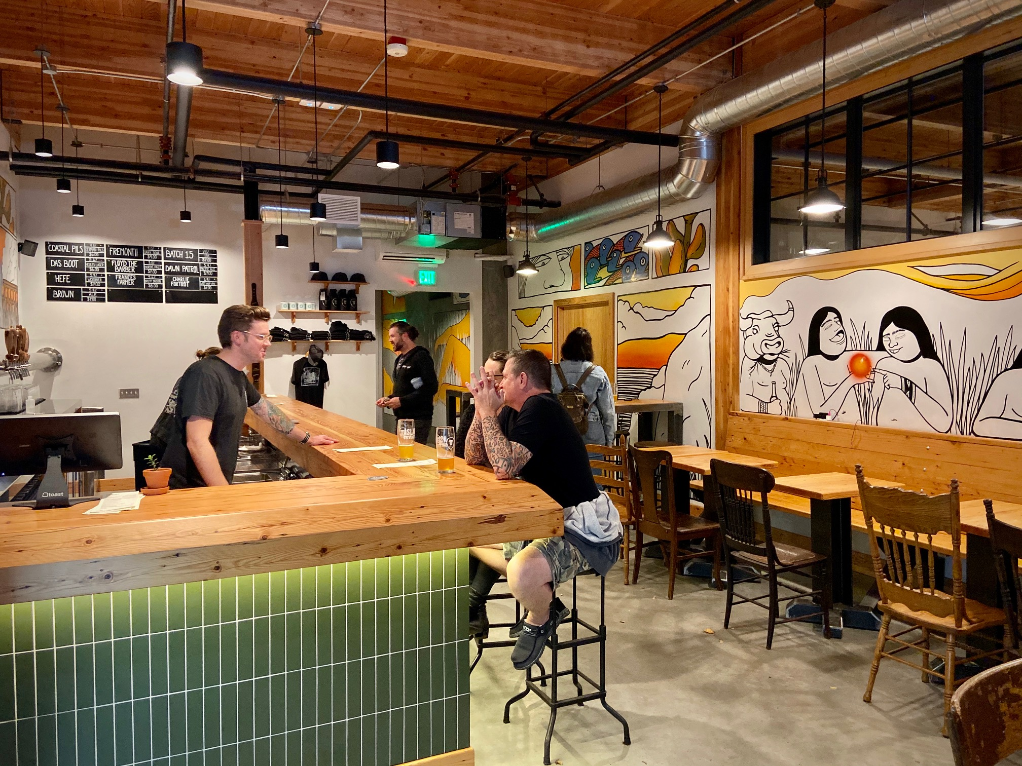 Inside the taproom at the new Aslan Brewing Seattle.
