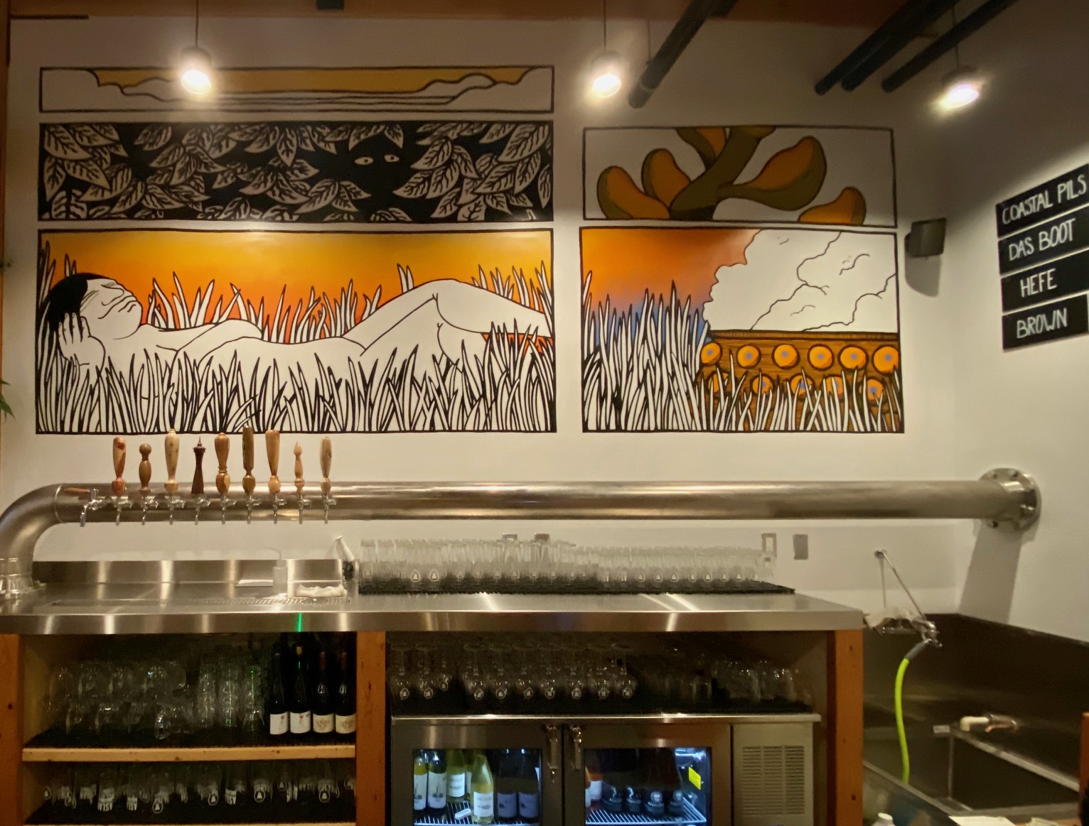 Nicely done mural artwork from Connor McPherson fills the walls at Aslan Brewing Seattle.