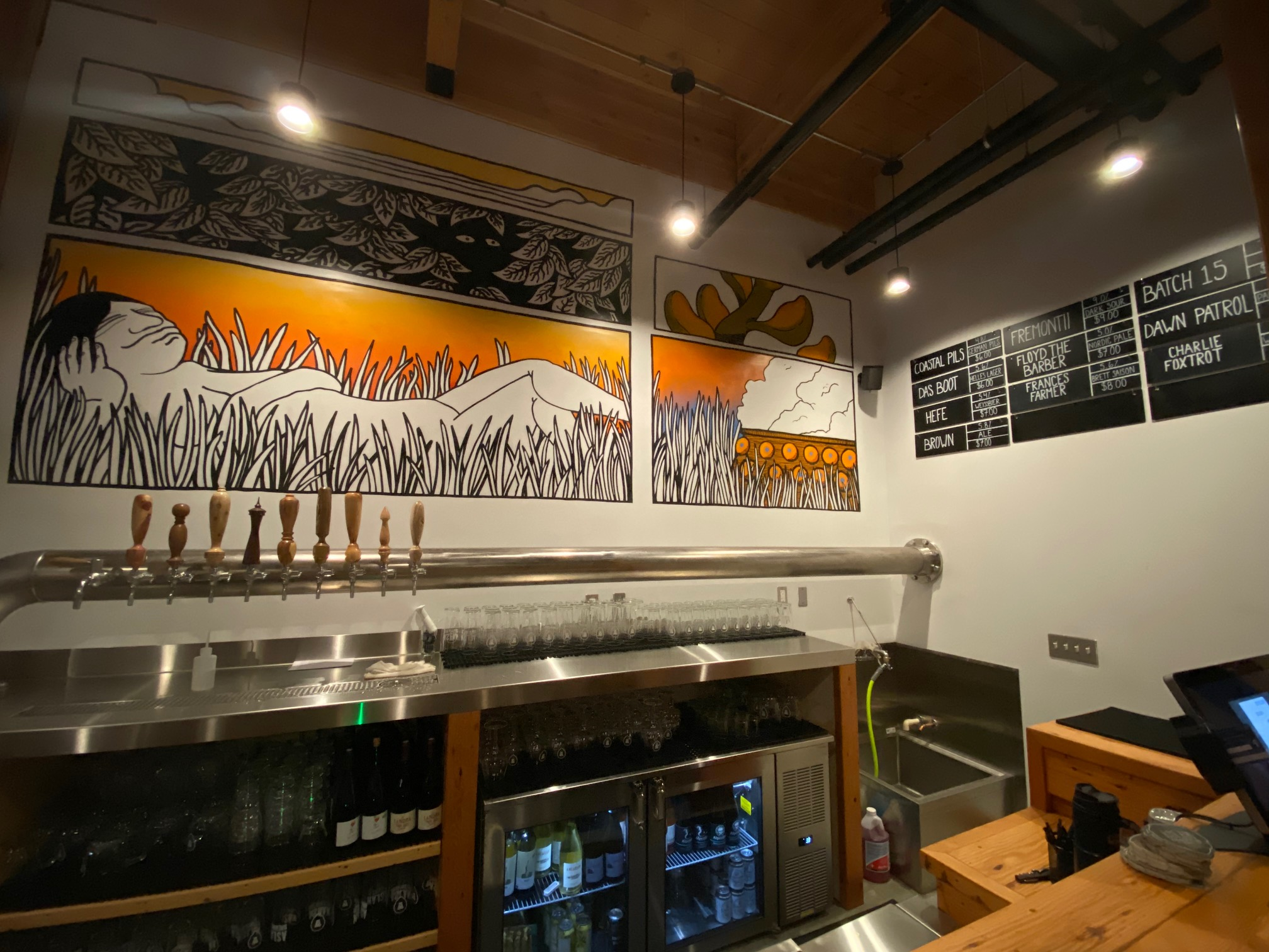 Ten taps of Aslan beer are offered at Aslan Brewing Seattle.
