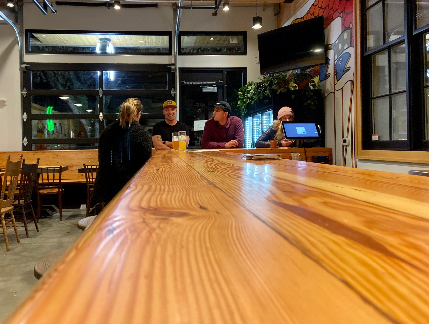 The impressive looking bar made of Douglas Fir at Aslan Brewing Seattle.