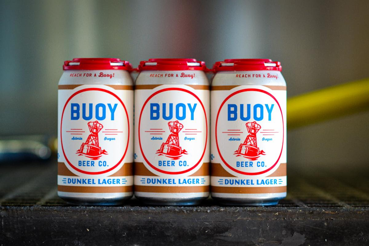 image of 12oz cans of Dunkel Lager courtesy of Buoy Beer Co.