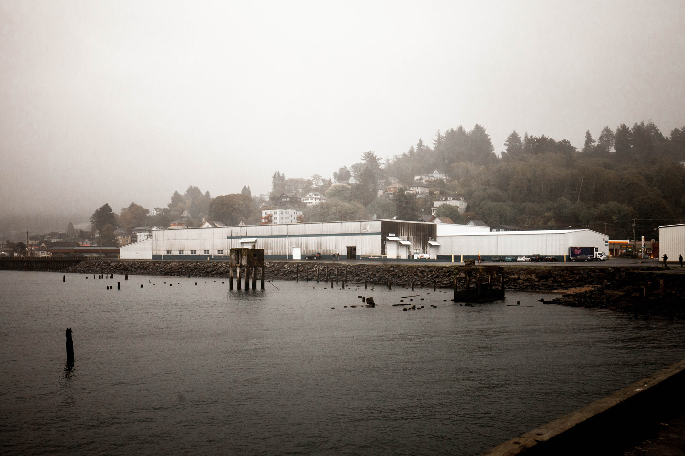 image of the new Fort George Warehouse on Astoria's waterfront courtesy of Tristan Paiige