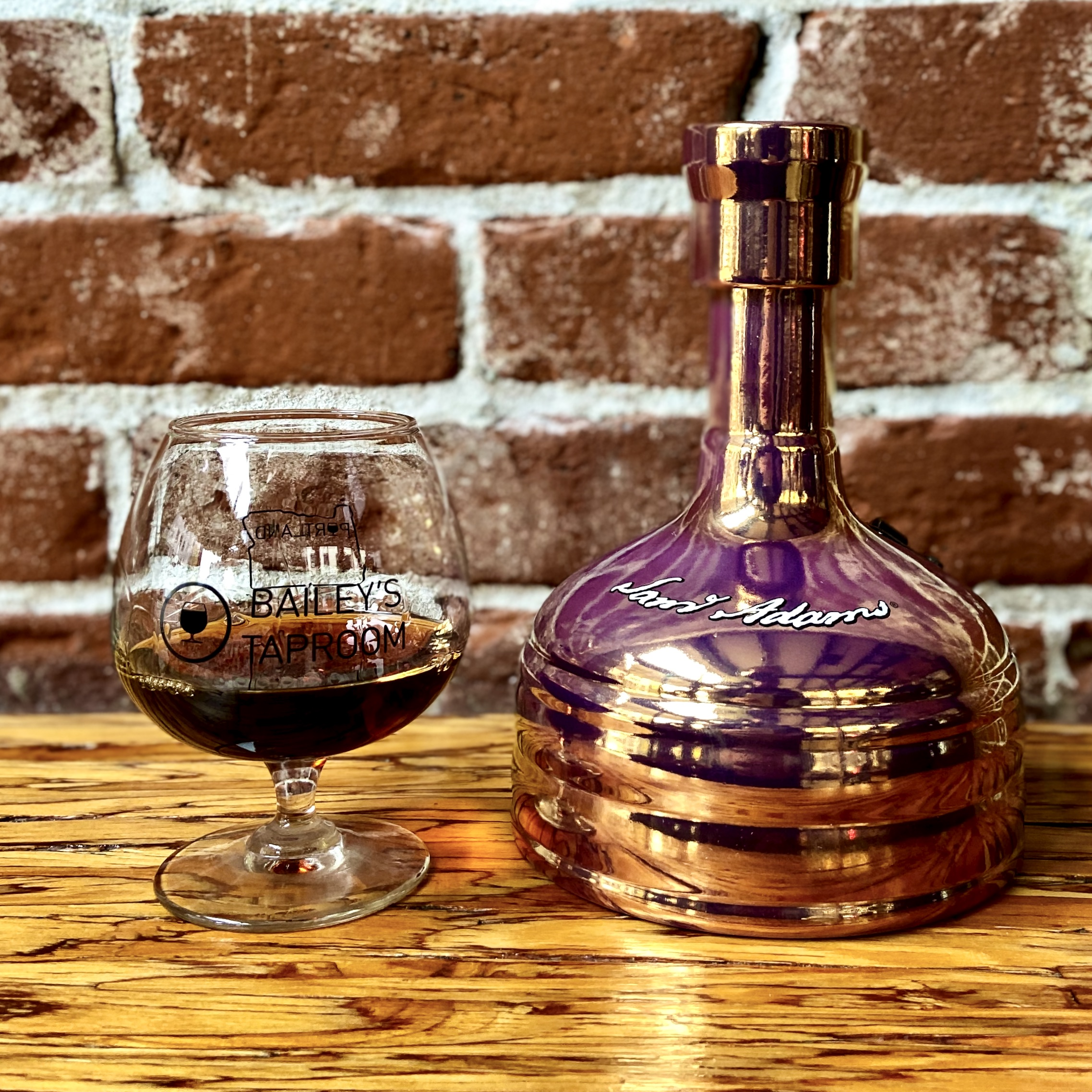 A glass pour of the 2019 Samuel Adams Utopias.