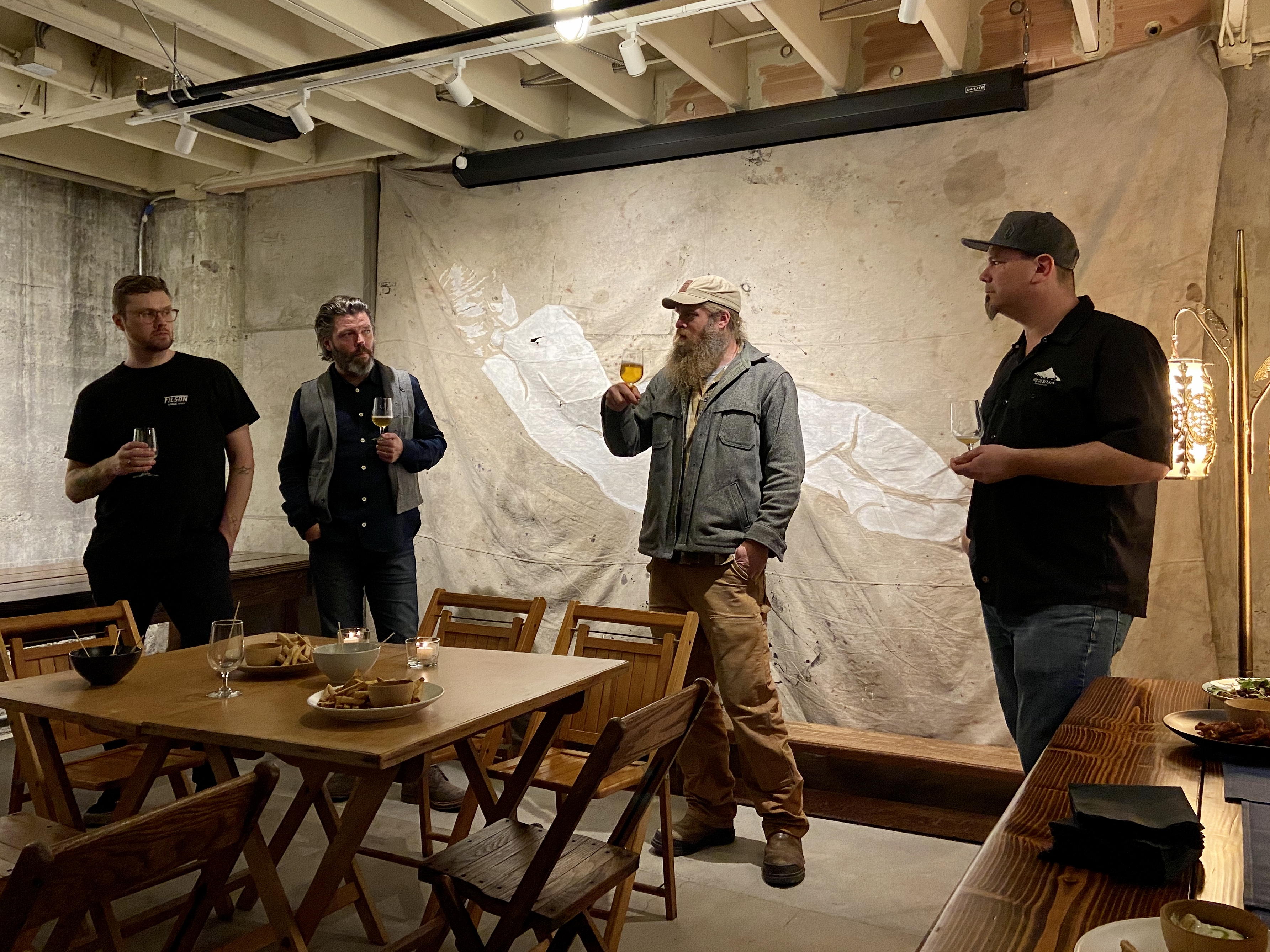 Olafur Agustsson, Kristinn Vilbergsson, Carston Haney, and Brandon Mikel discussing KEX Brewing beers that are brewed at Ross Island Brewing for its Oregon distribution.