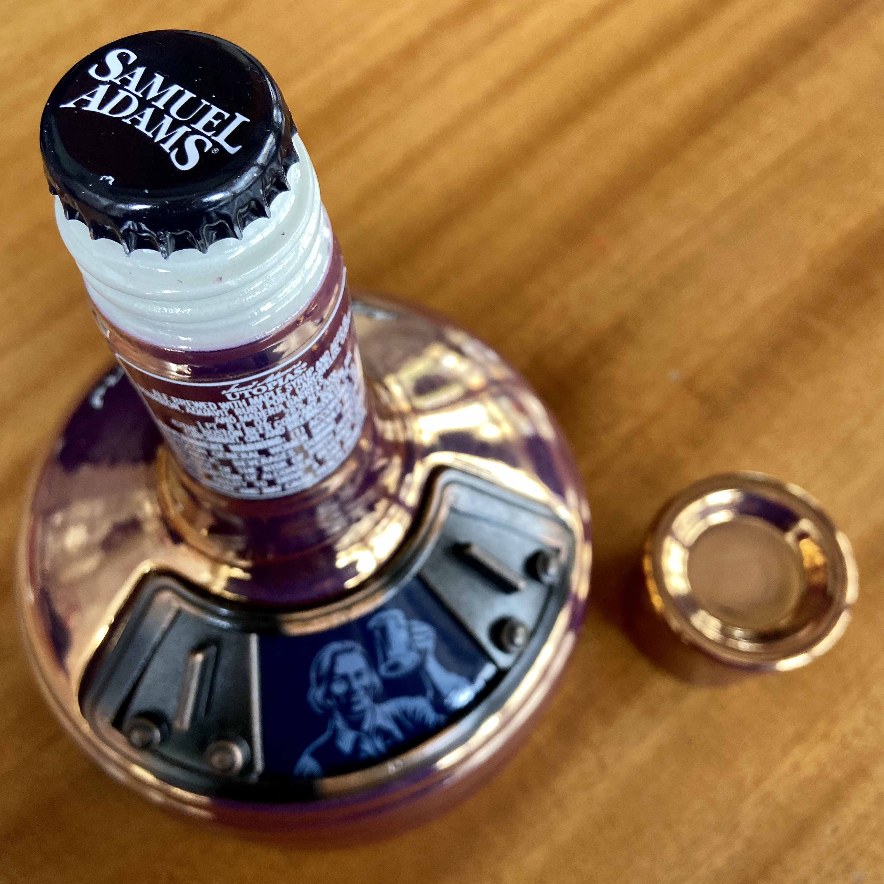 The bottle that Samuel Adams Utopias is hand bottled in is a very elegant presentation. The 25.4oz ceramic decanter looks like a mash tun with doors that open and close.