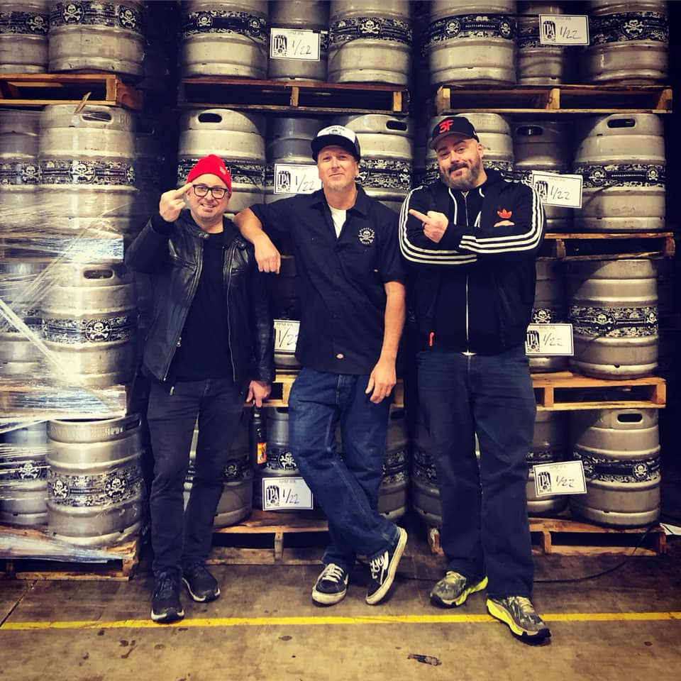 Tony Lawrence of Boneyard Beer surrounded by Chris Boggess and Nick Floyd of 3 Floyds Brewing. (image courtesy of Boneyard Beer)