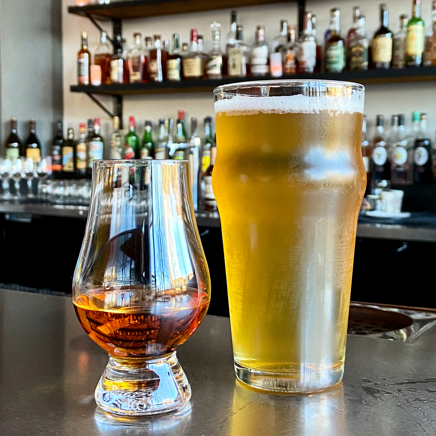 ShiftBeer Single Hop Pale Ale from StormBreaker Brewing and a neat pour of 13 Year Elijah Craig Single Barrel Bourbon at Shift Drinks.