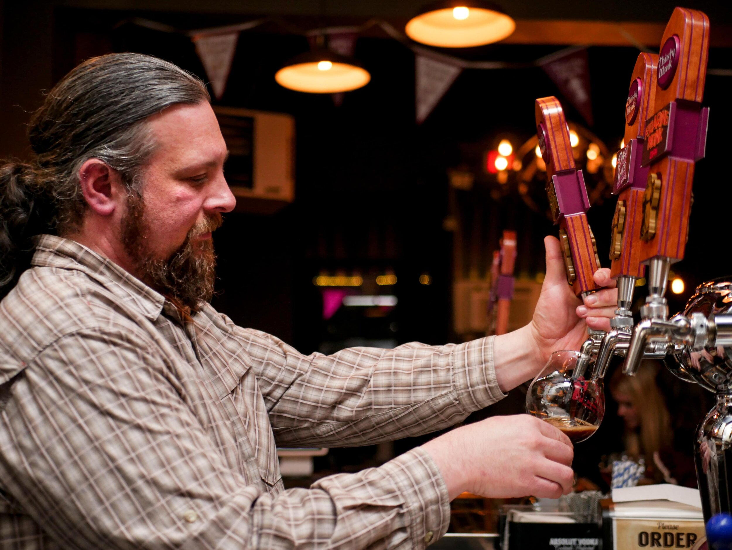 image of Opus pouring a beer courtesy of Thirsty Monk - Portland
