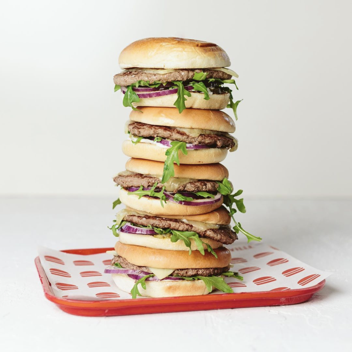 image of a stack of Hopyard Cheddar Burger courtesy of Burgerville