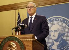 Washington Gov. Jay Inslee announces the closure of bars and restaurants due to the COVID-19 Pandemic. (AP Photo:Rachel La Corte)
