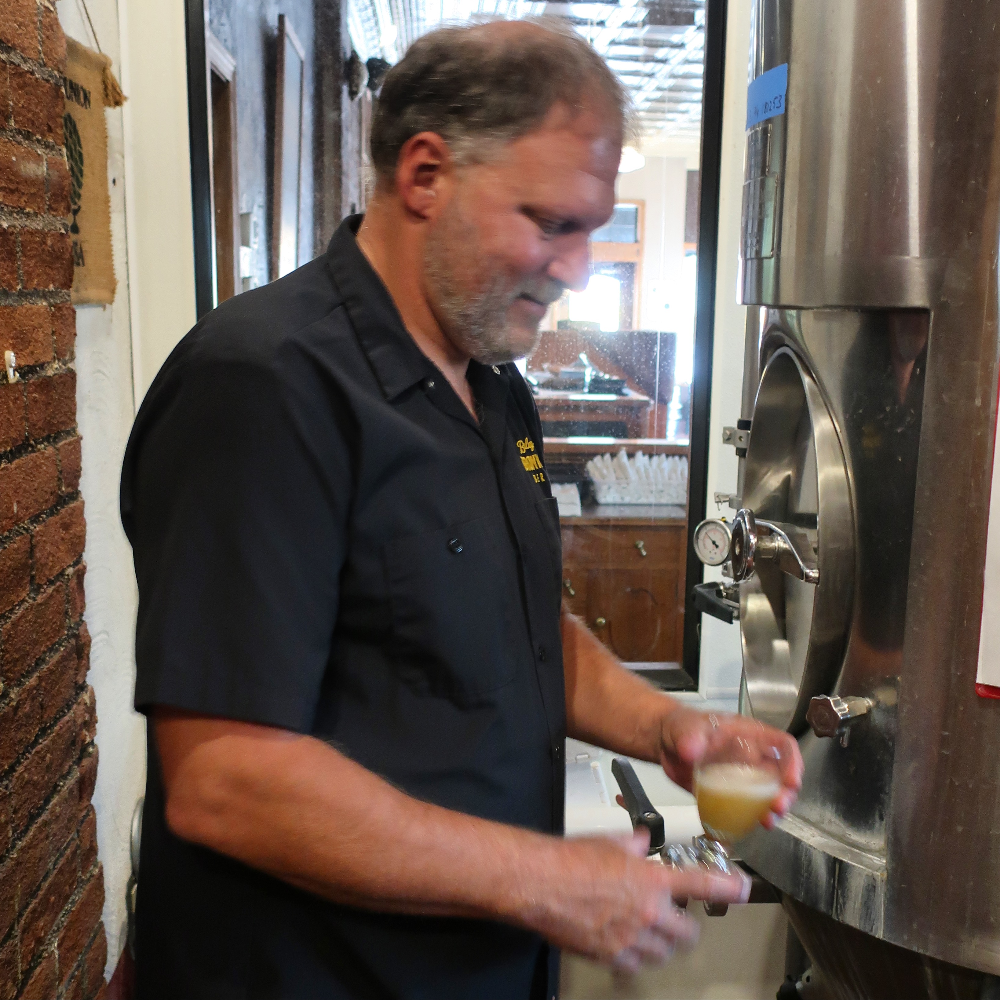 Tyler Brown pouring a beer off the zwickel at Barley Brown's Beer in Baker City, Oregon.