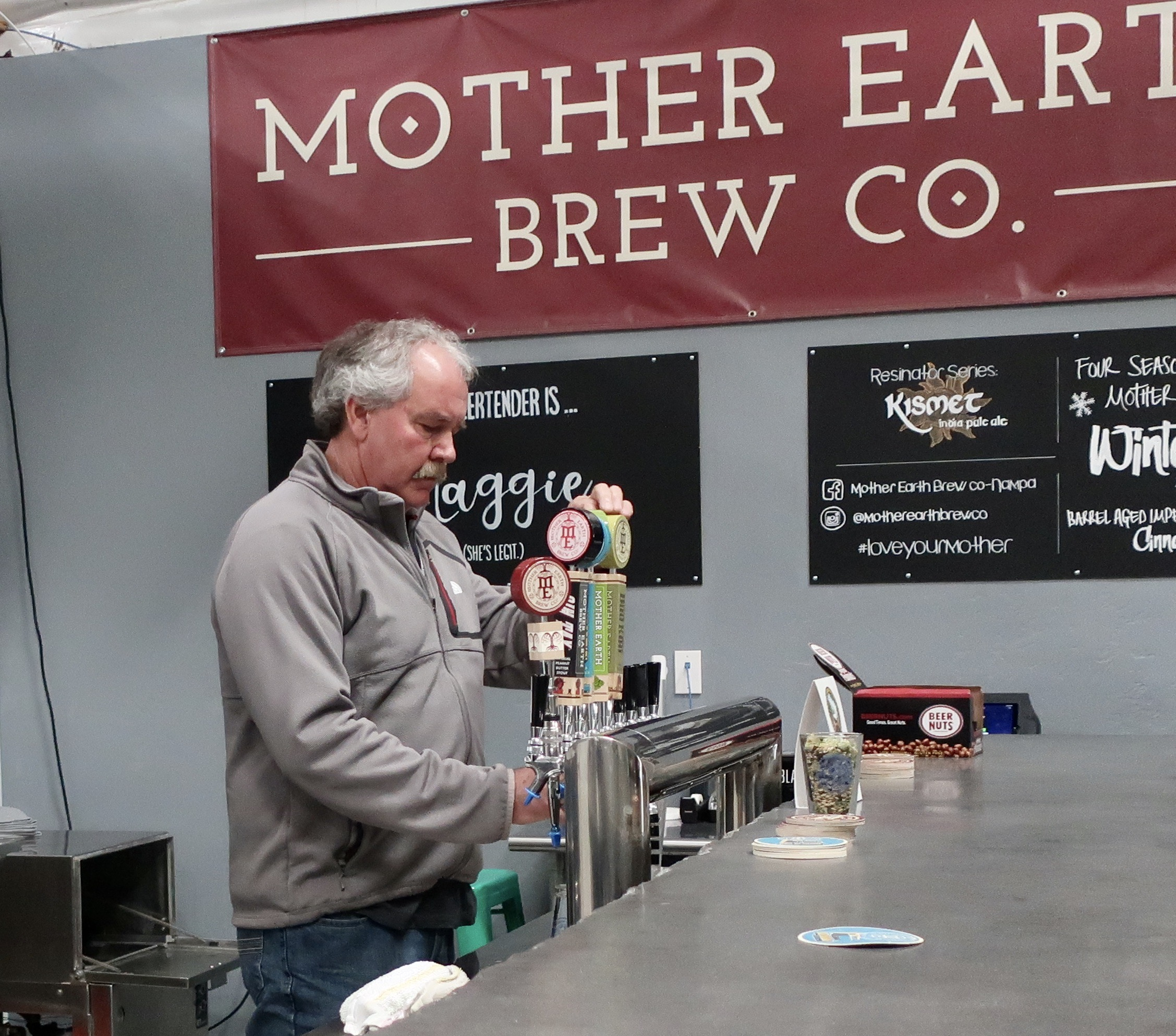 Daniel Love serving a beer at Mother Earth Brewing Co. in Nampa, Idaho during March 2019.