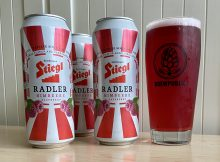 A 16.9oz can of Stiegl Radler Raspberry served in a BREWPUBLIC glass.