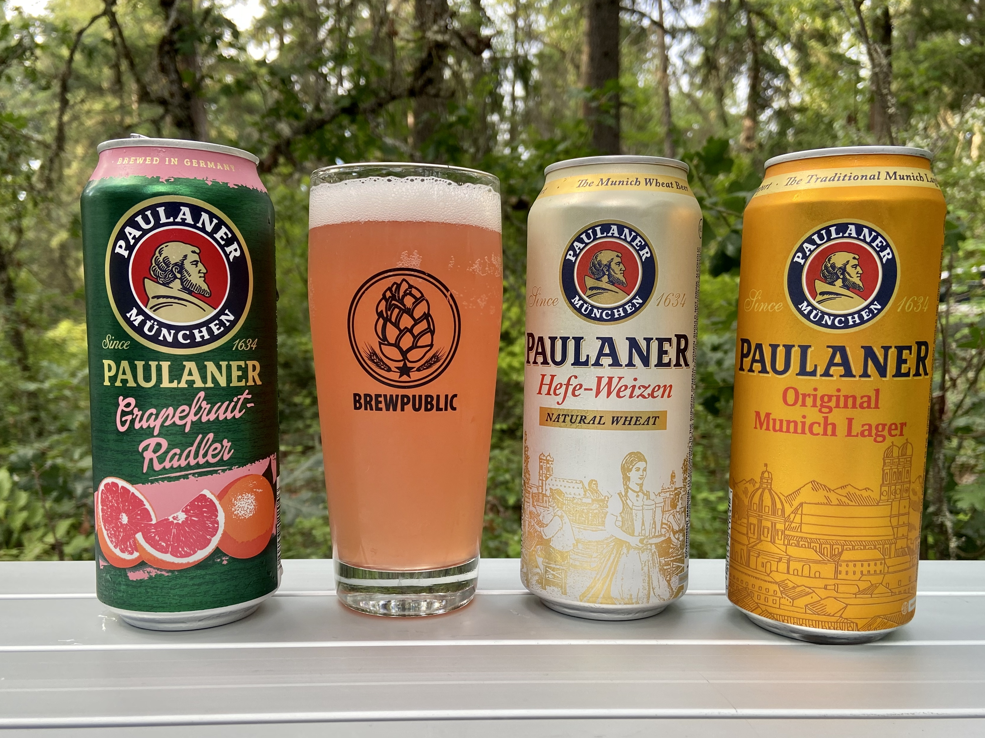 An assortment of beer from Paulaner - Paulaner Grapefruit Radler, Paulaner Hefe-Weizen, and Paulaner Original Munich Lager
