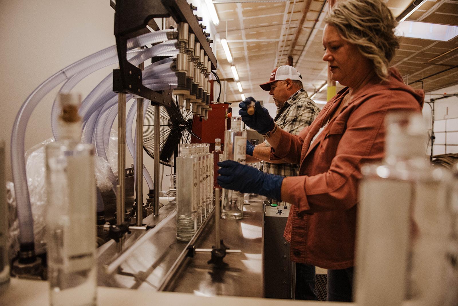 Olympia Master Distiller Lesa Givens bottling Olympia Artesian Vodka.(image courtesy of Sarah Russell)