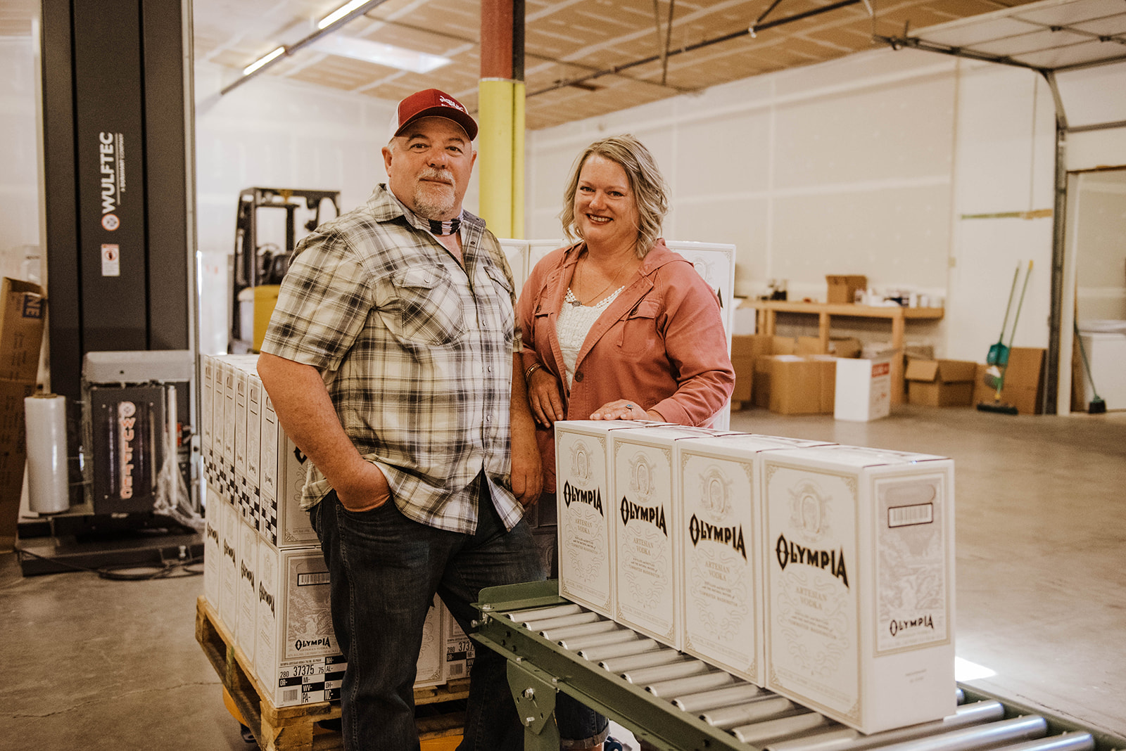 Olympia Master Distillers - Ray Watson and Lesa Givens packaging Olympia Artesian Vodka.(image courtesy of Sarah Russell)