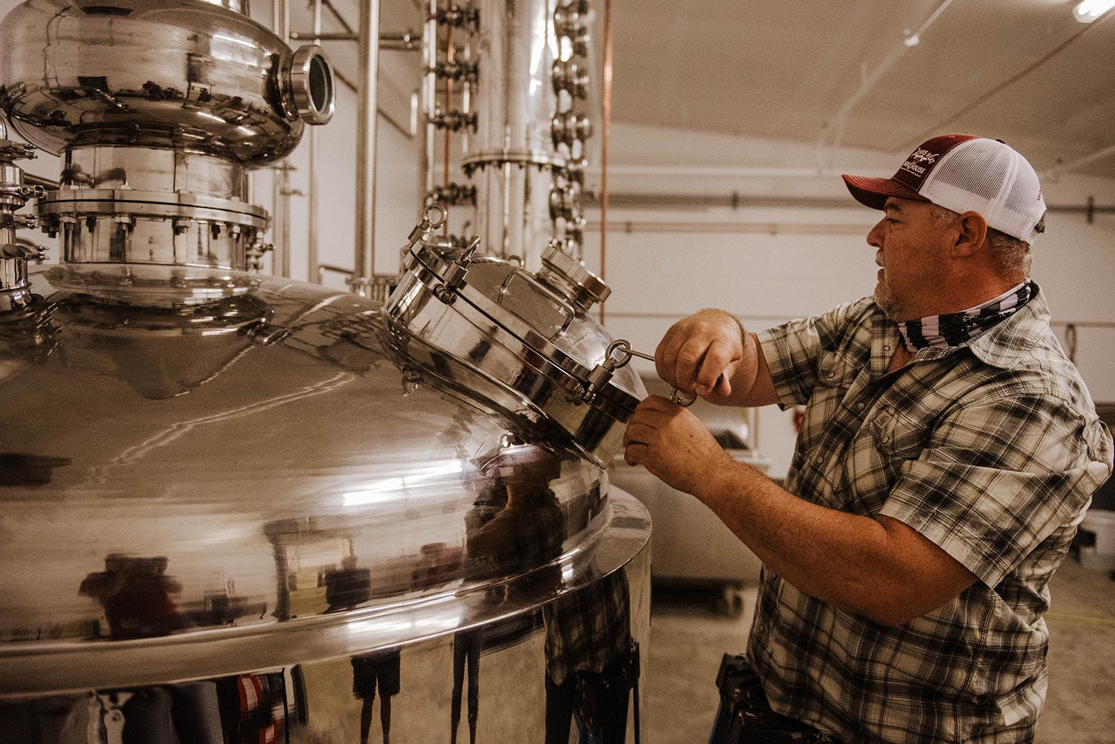 Olympia Master Distillers Ray Watson making Olympia Artesian Vodka in Tumwater, Washington.(image courtesy of Sarah Russell)