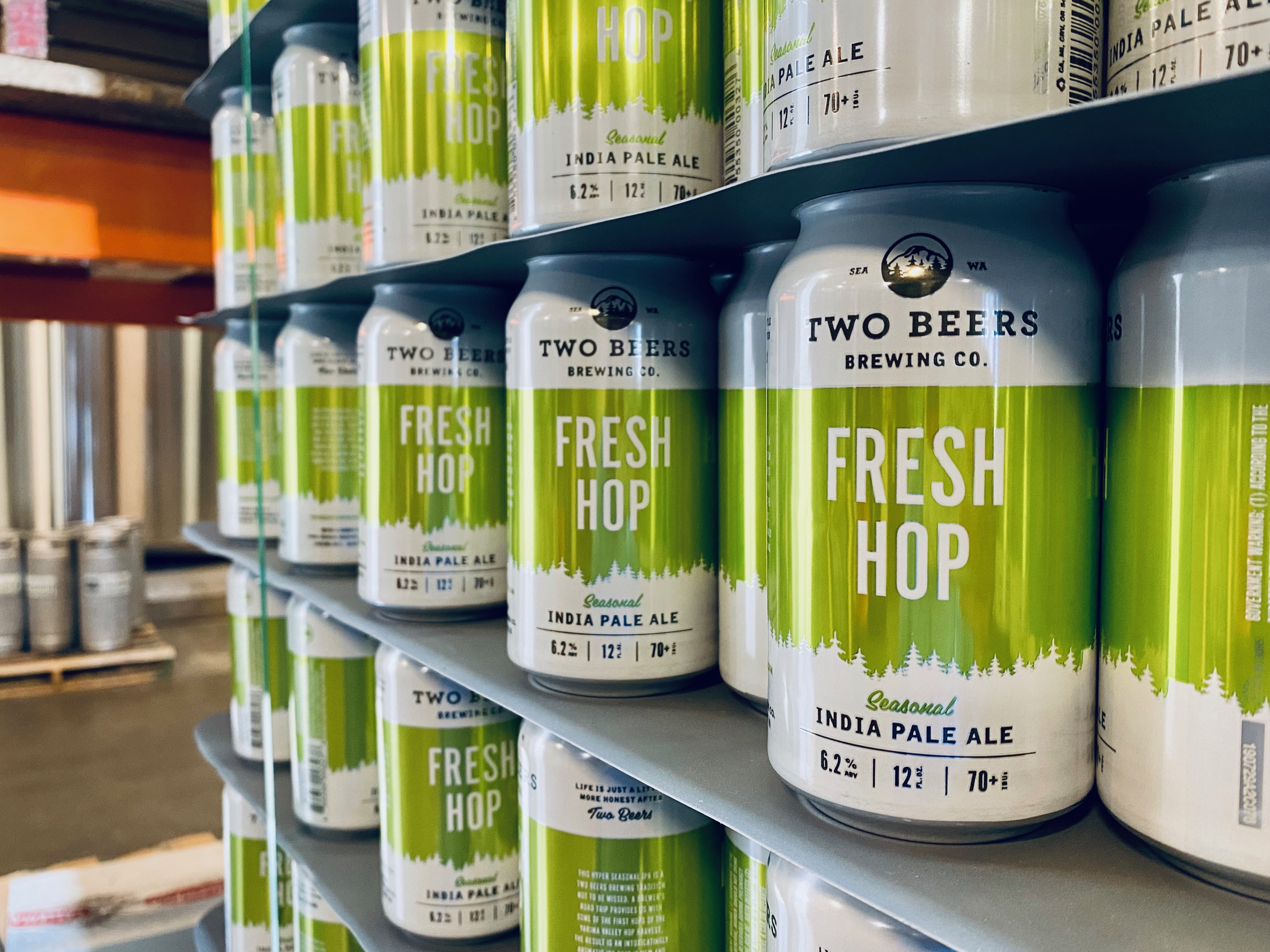 Stacks of empty cans of Fresh Hop IPA that will be filled in the coming days. (image courtesy of Two Beers Brewing Co.)