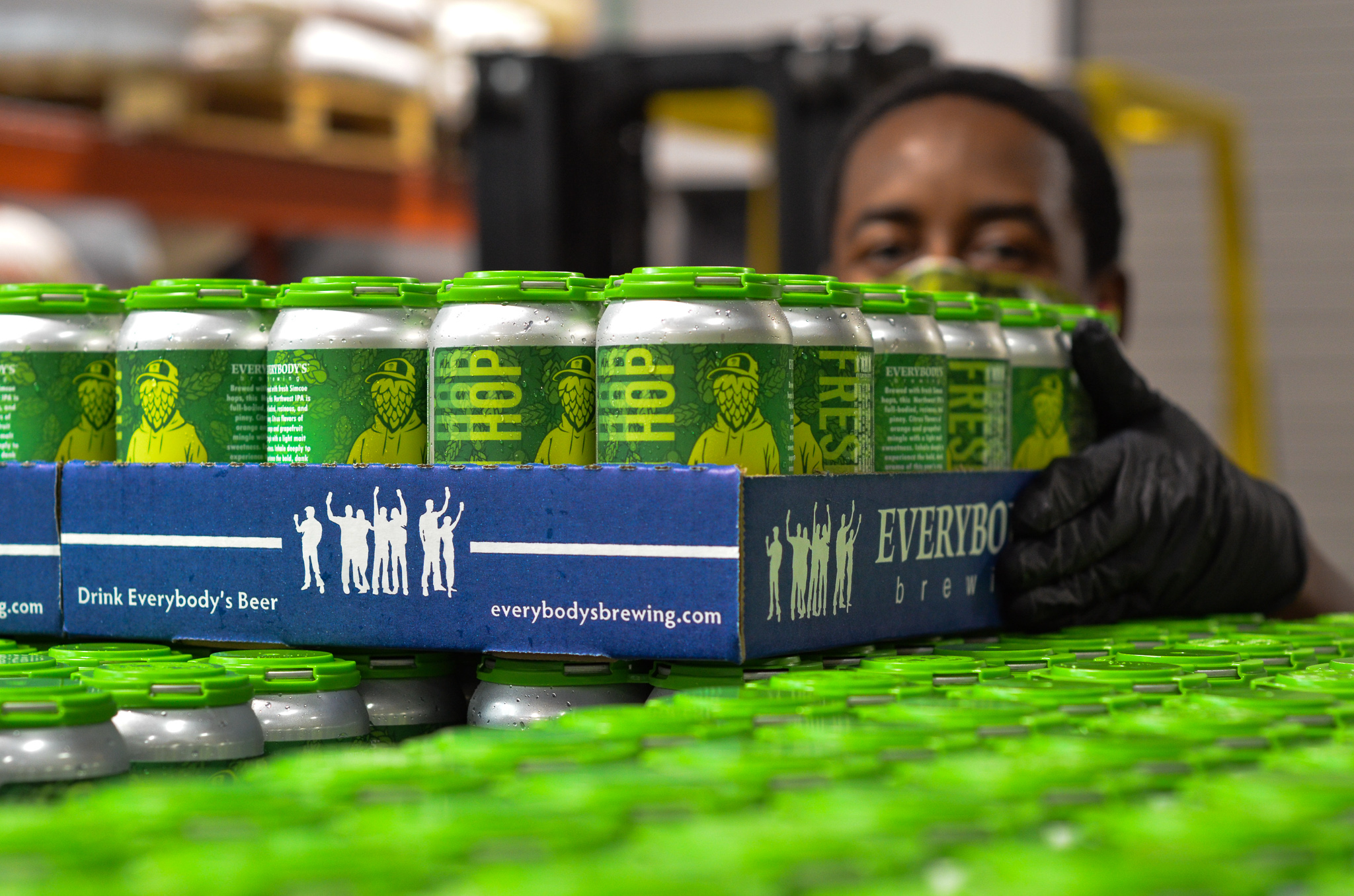 The brew team at Everybody's Brewing stacks a pallet of Head Stash Fresh Hop IPA. (image courtesy of Everybody's Brewing)