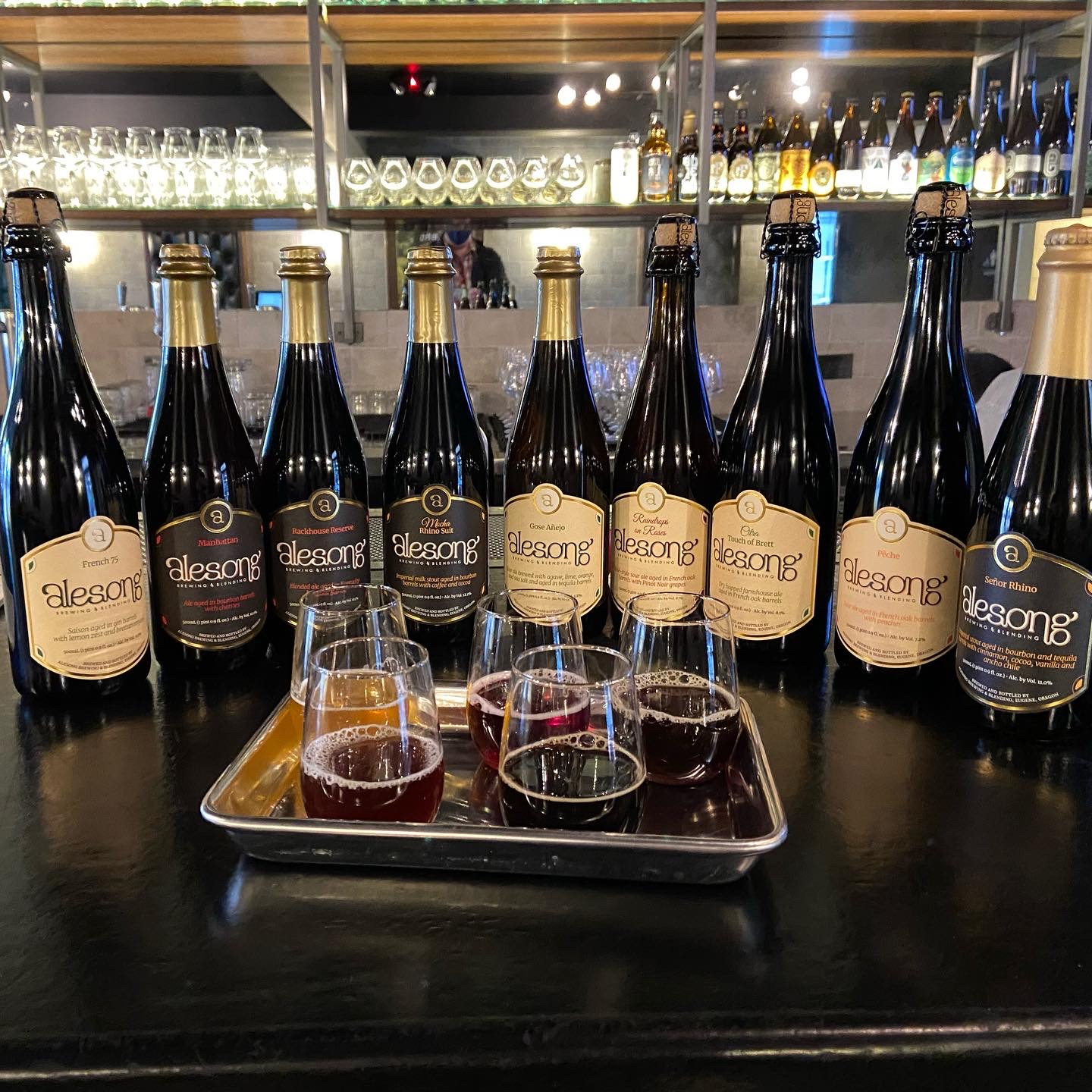 Alesong Brewing & Blending Fall 2020 Releases - French 75, Terroir Project, Rackhouse Reserve, Manhattan, and Mocha Rhino Suit - alongside other bottles available from the brewery's Beer Store.