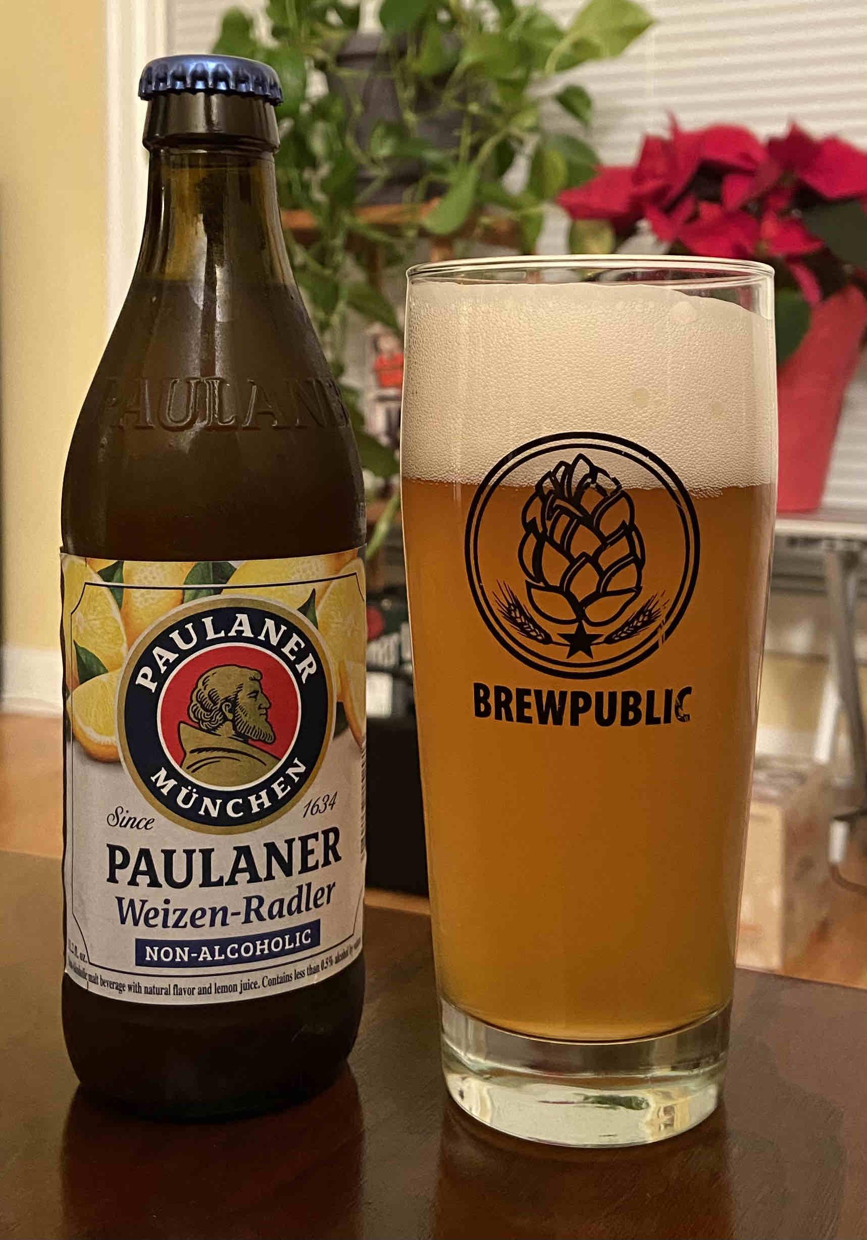 A glass pour of Paulaner Non-Alcoholic Weizen-Radler
