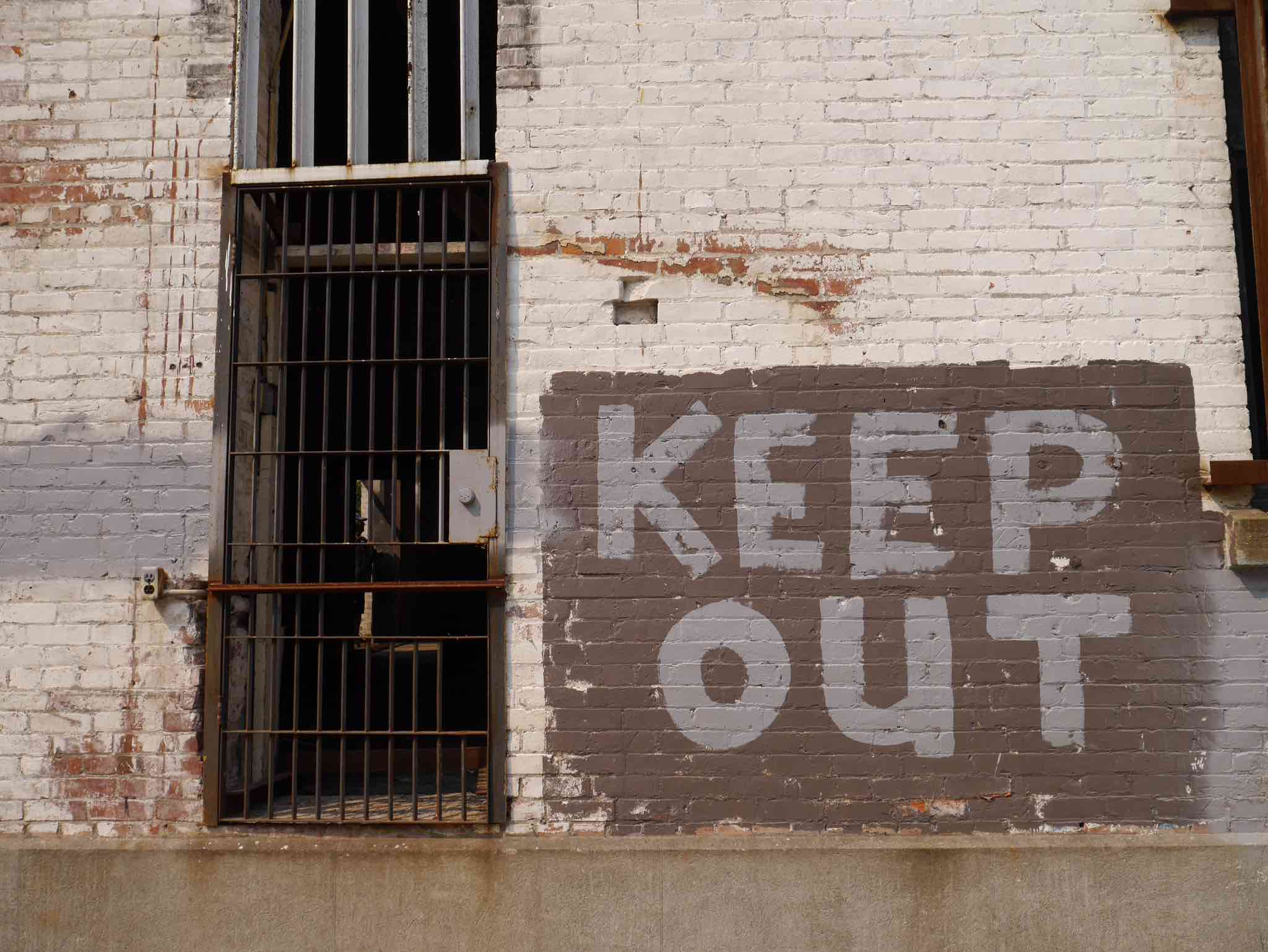 Keep Out greets you outside the original Olympia brewery in Tumwater, Washington. (photo by Cat Stelzer)