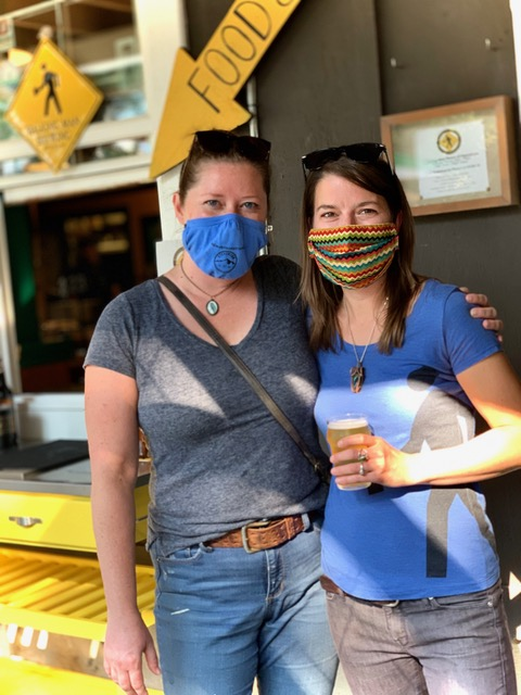 Walking Man Brewing owner Tabatha Wiggins and former brewer Emily Albaugh. (image courtesy of Walking Man Brewing)
