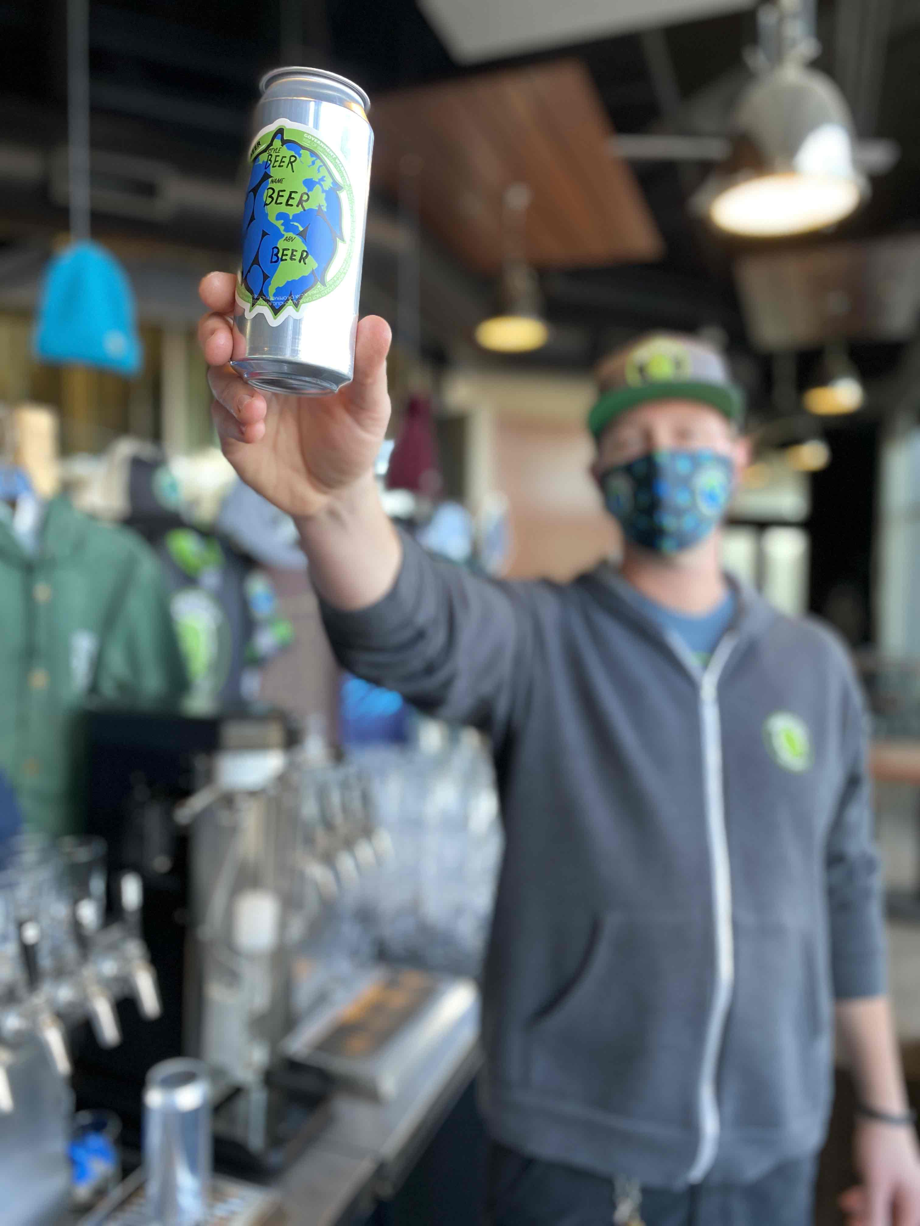 image of Dustin Keller holding a 16oz can courtesy of Worthy Brewing