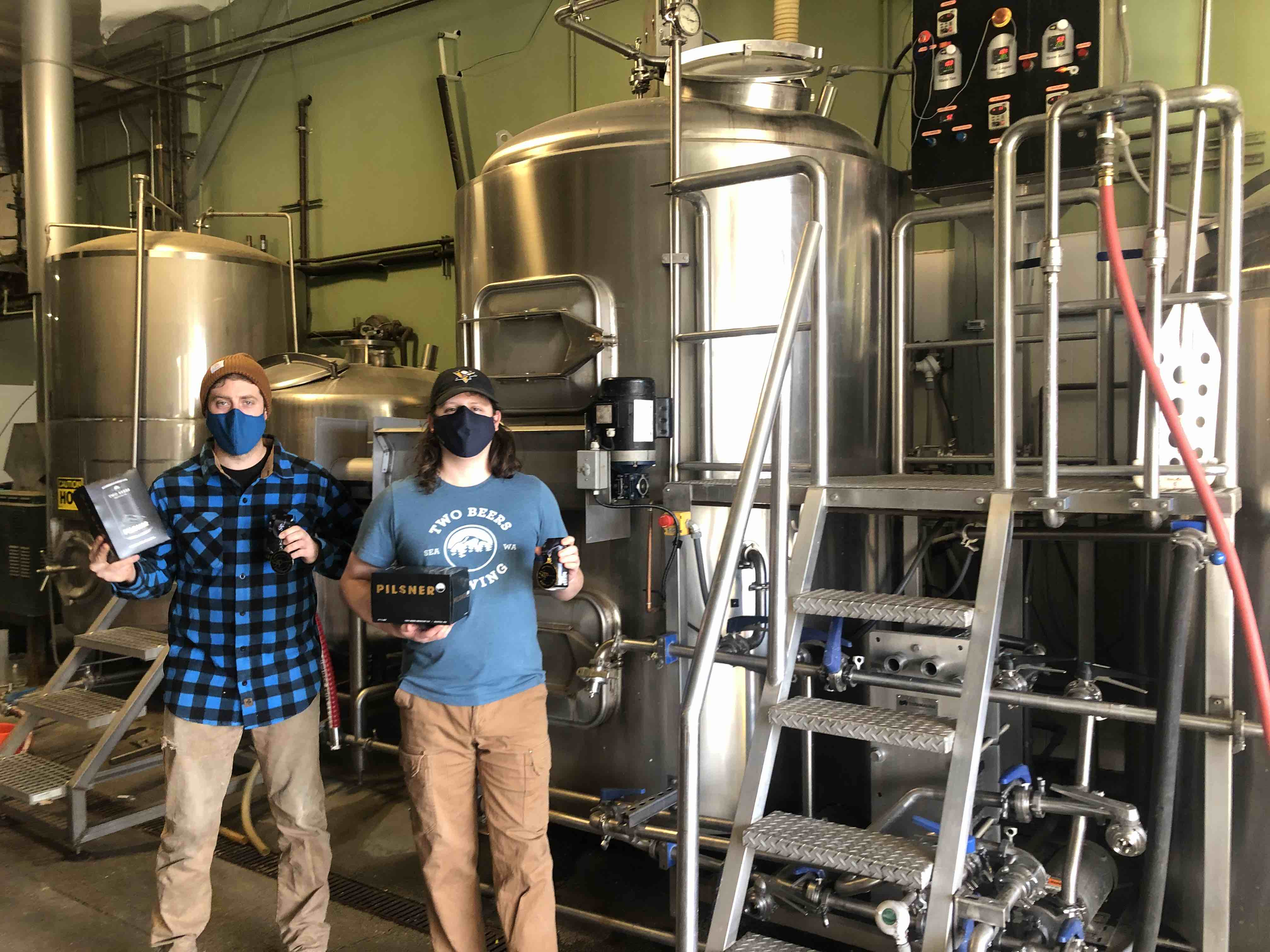 image of Head Brewer, Jesse Ransavage and Assistant Brewer, Andrew Potts with Pilsner courtesy of Two Beers Brewing