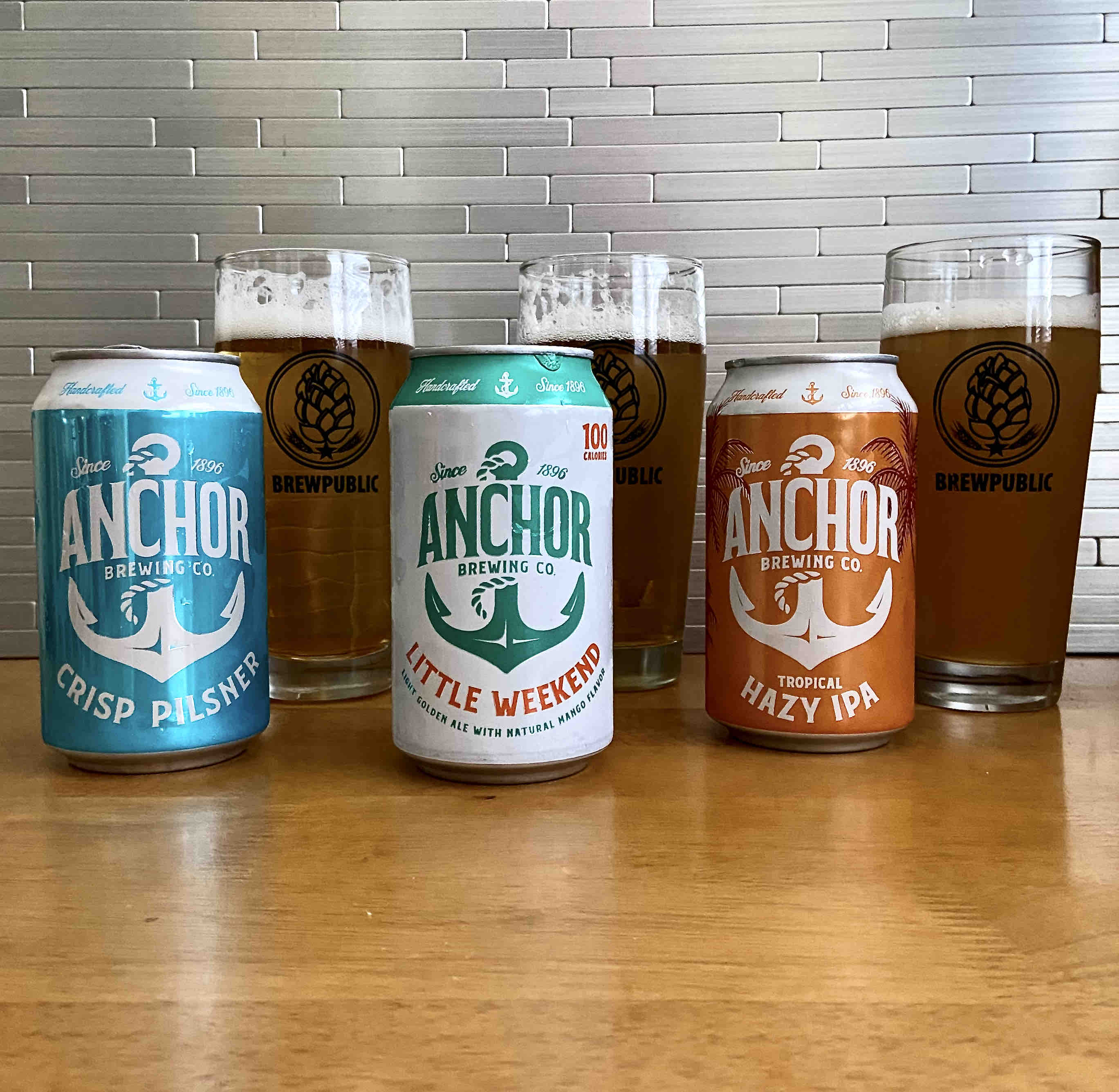 Anchor Brewing releases Crisp Pilsner, Little Weekend, and Tropical Hazy IPA in 12oz cans.