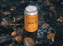 image of Nature Nut, a beer brewed with Justin's to benefit the Rocky Mountain Conservancy courtesy of Athletic Brewing Company