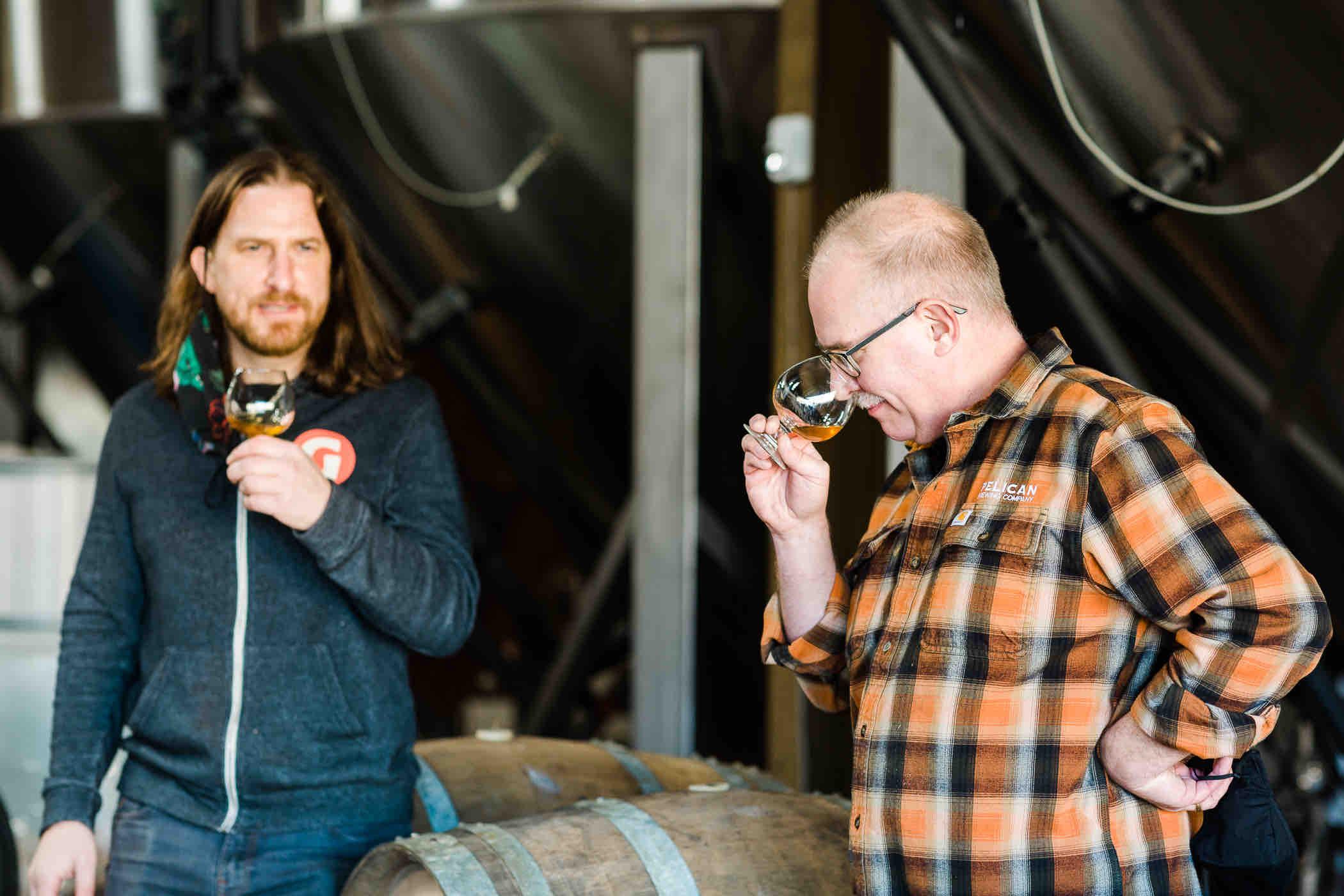 Ben Love and Darron Welch sampling Bird-Day Volume II Tangerine Golden Ale Aged in Mezcal Barrels. (image courtesy of Pelican Brewing)