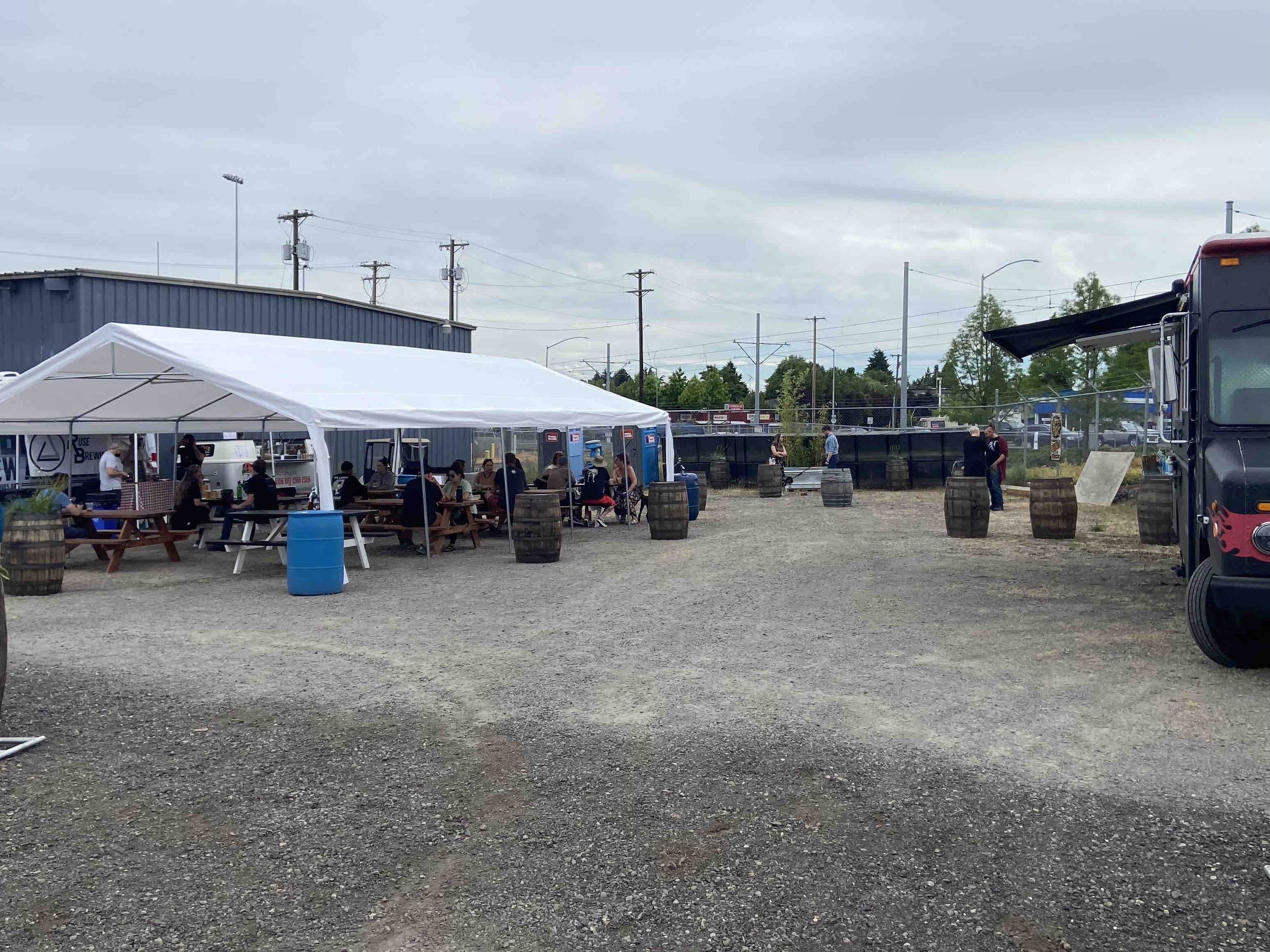 The parking lot that has transitioned into the new Brooklyn Garden. This new weekend outdoor space features Ruse Brewing, 503 Distilling, and Adega Northwest Wines.