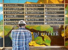 The taplist with a stained glass mosaic print adorns the backdrop of the bar at Proper Pint Oakroom.