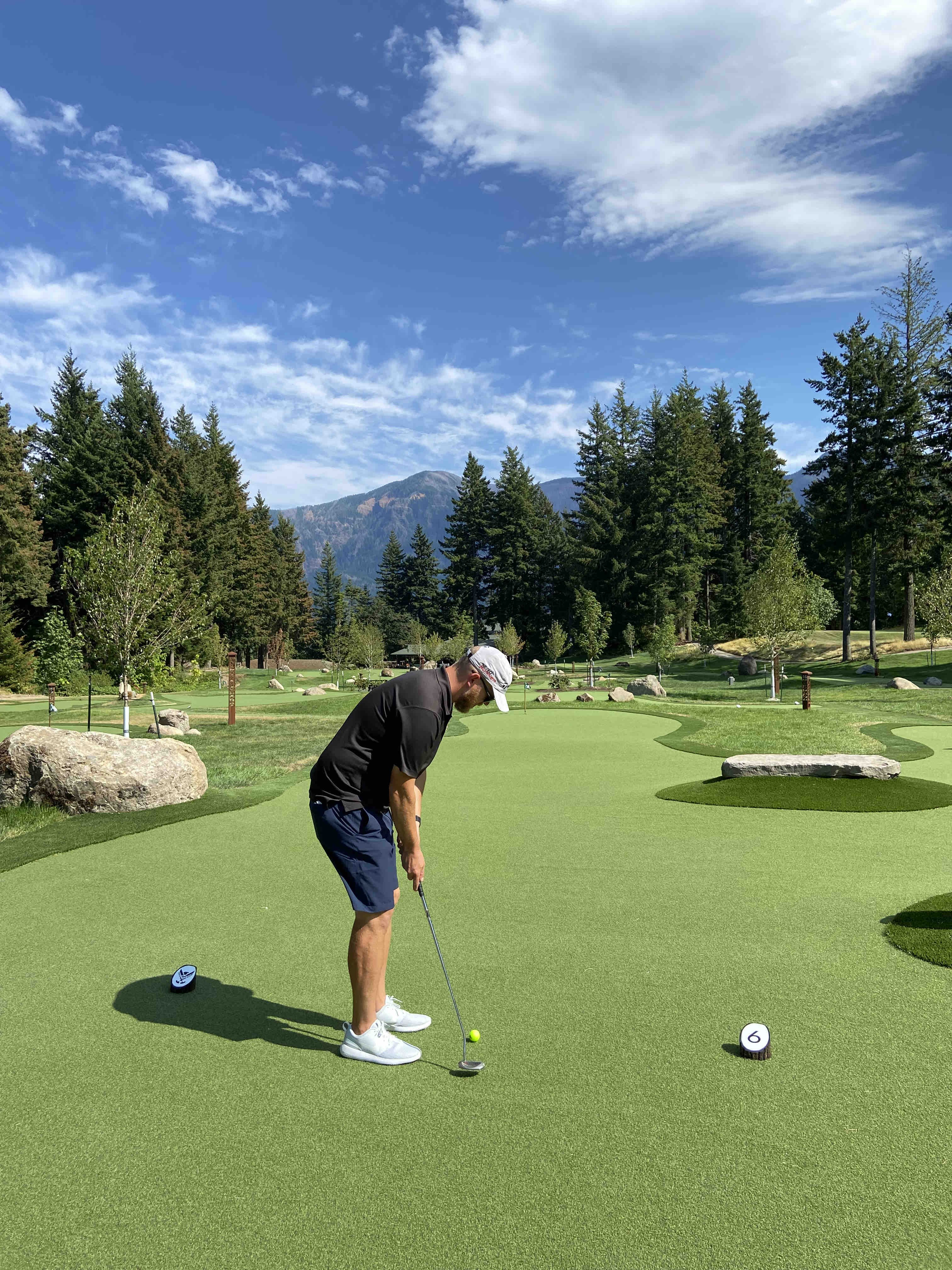 Taking a putt on The Little Eagle 18 Hole Putting Course at Skamania Lodge.