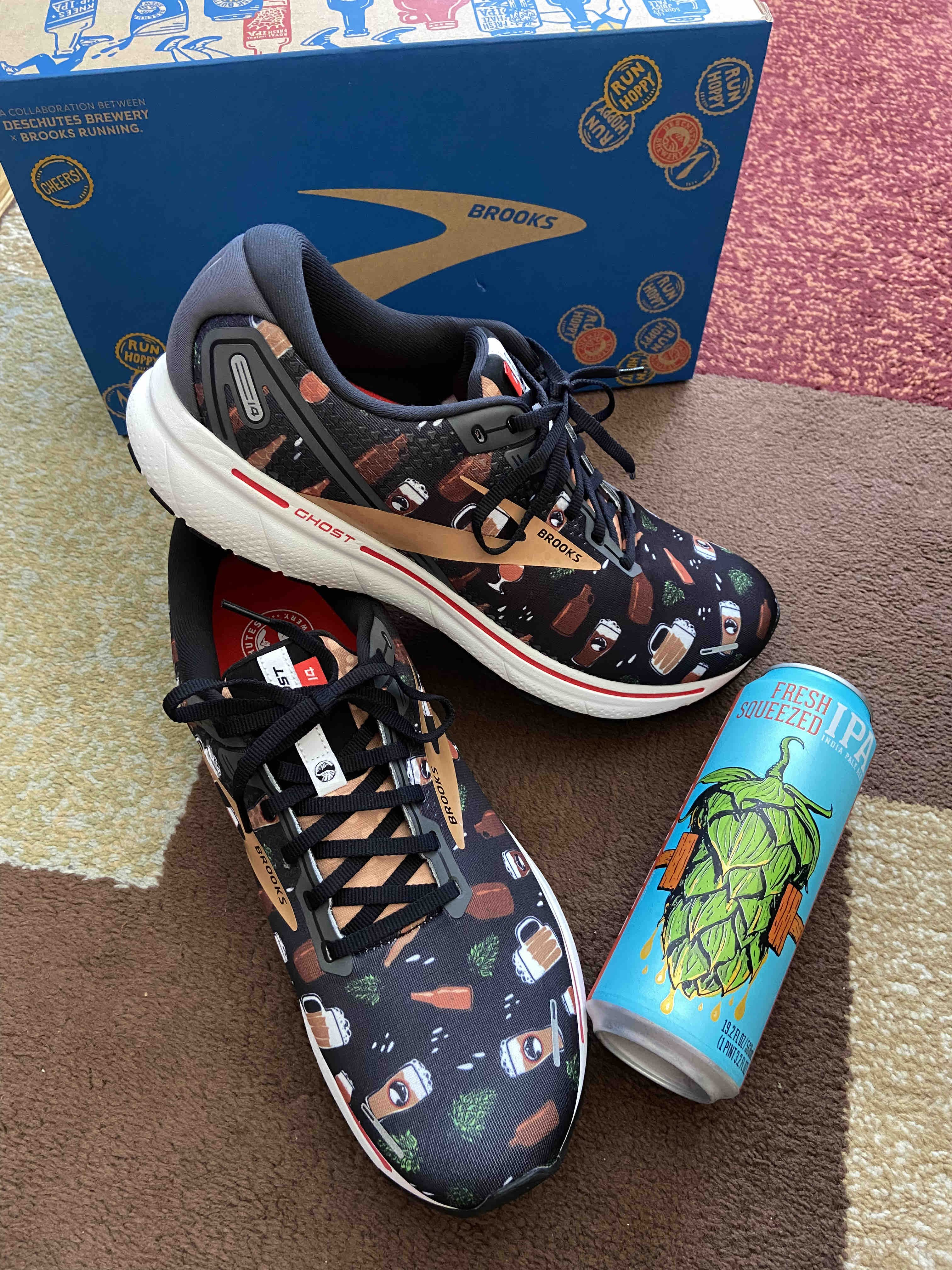 Deschutes Brewery and Brooks Running Deschutes themed Run Hoppy Ghost 14 Road Running Shoes and a 19.2oz can of Fresh Squeezed IPA.