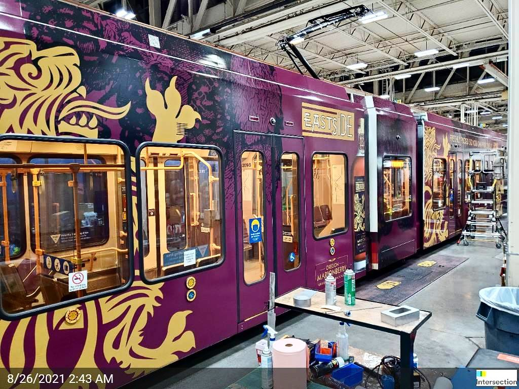 Be on the lookout for the Eastside Distilling Oregon Marionberry Whiskey decorated TriMet train. (image courtesy of Eastside Distilling)