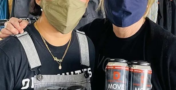 image of Dovetail Workwear's Sara DeLuca and Deschutes brewer Veronica Vega holding cans of Move Maker Cold IPA courtesy of Dovetail Workwear